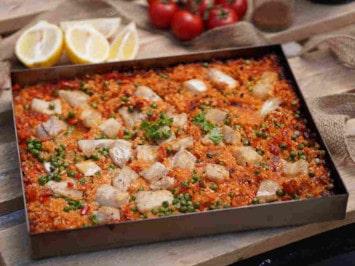 Rezept: Paella im Pizzaofen schmoren